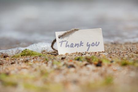 agradecimiento: Gracias - signo en la playa