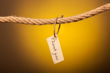 thank you note tethered to the rope Stock Photo