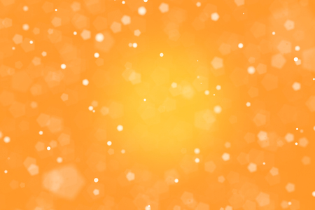 An orange color bokeh background. Banco de Imagens