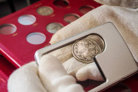 red album with old collectible finnish coins