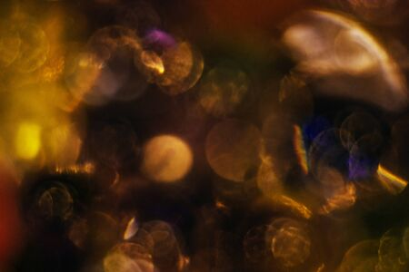 Abstract texture, gold with violet colors balls of hydrogel for the background. Hydrogel beads.