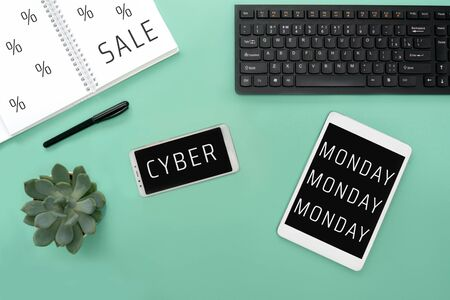 Cyber Monday flat lay on white background. Keyboard, tablet, phone, mous and succulent composition.