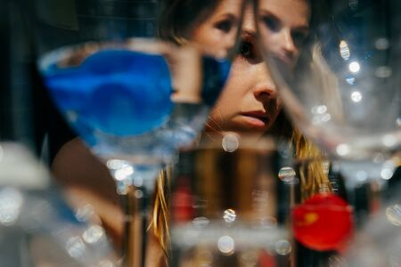 The girl is through the glasses.