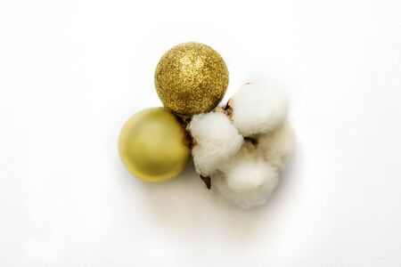 Christmas element from cotton and golden christmas balls on white isolated. Stock Photo