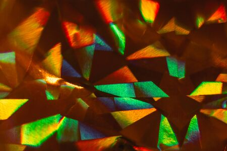 Aggressive colors, abstract composition from triangles. Red, yellow, green, blue, orange on black background Macro Stok Fotoğraf