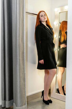 Beautiful woman in a dressing room in dress jacket. Foto de archivo