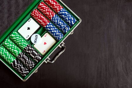 the aluminium suitcase with poker set, top view, copy space