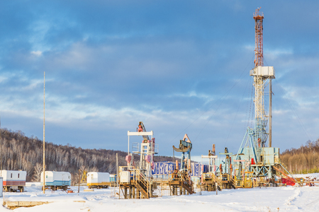 onshore: land onshore oil drilling rig blue sky