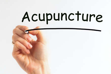 Hand writing inscription Acupuncture with black marker, concept