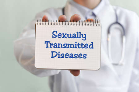 Doctor writing word Sexually Transmitted Diseases with blu marker, Medical concept Imagens