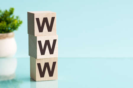 The Word WWW On Wooden Blocks And Arranged By Male Fingers On A Table 免版税图像