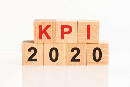 KPI 2020 word written on wood block. Faqs text on table, concept. Key Performance Indicators, KPI