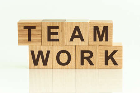 Team Work - text on wooden cubes on a gradient background. HUMAN RESOURCES the ability of a group of people to work well together