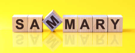 sammary word written on wood block. sammary word is made of wooden building blocks lying on the yellow table. content, business concept, yellow background