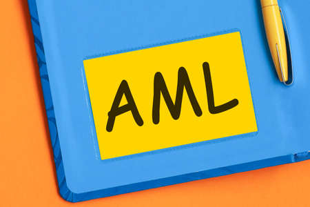 aml the word is written in black letters on the yellow paper for notes Stock Photo