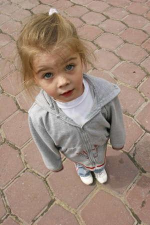 looking upwards: Little girl looking upwards Stock Photo