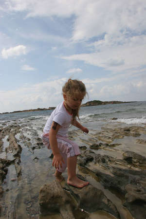 Girl on cloudy coast photo