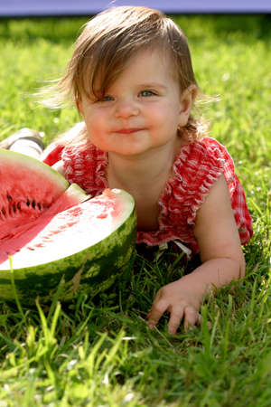 Girl eating water-melon photo