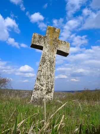 Exalted stone cross in Moldova cemetery