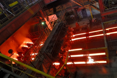 casting: steel works, continuous casting machine Stock Photo