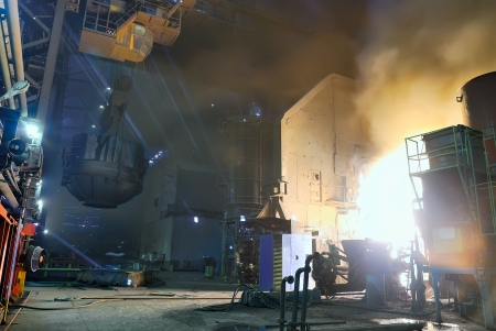 casting: steel works, charging of a furnace Stock Photo