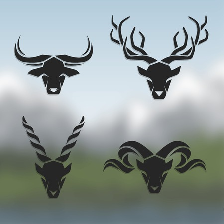 Logos horned animals. On blurred background. Buffalo deer mountain goat mountain sheep. Vector