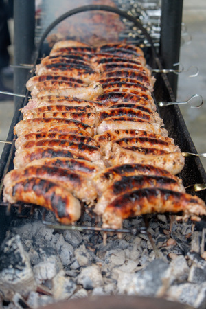 flesh eating animal: many ribs and sausages cooked on the grill outdoor