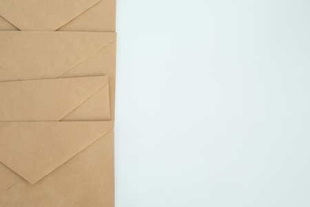 airtight: several envelopes from brown letter paper, on white background close-up, top view