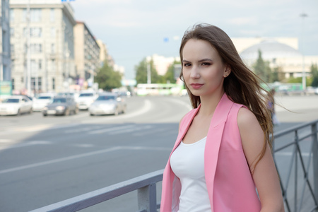 Young woman posing on road background