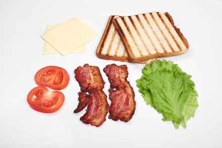 Ingredients for making sandwich. fresh vegetables, tomatoes, bread, becon, cheese. Isolated on white background, top view copy space Standard-Bild