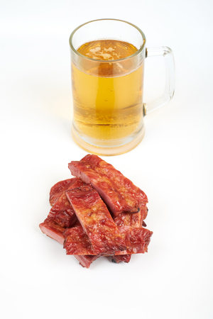 Grilled pork ribs and beer isolated on white background