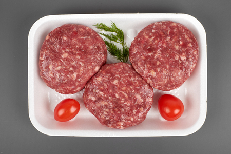 minced meat in plastic package isolated on white background