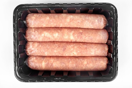 Package of raw sausages isolated on white background.