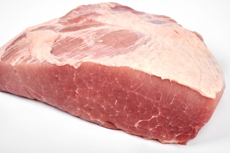 A large piece of pork isolated on white