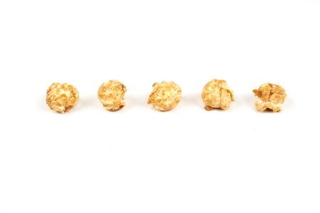 caramel popcorn on white background.