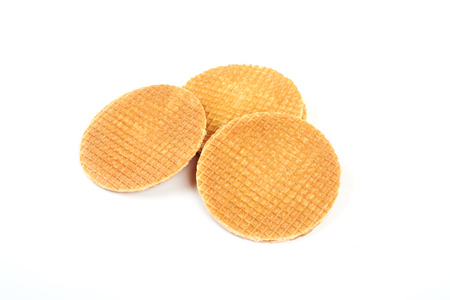 Dutch waffle called a stroopwafel isolated on a white background Stockfoto