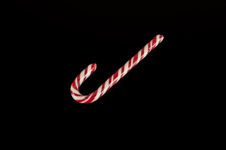 Traditional christmas candy on black background, photo in studio.