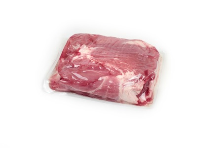 Fresh pork meat in vacuum packed, isolated on a white background