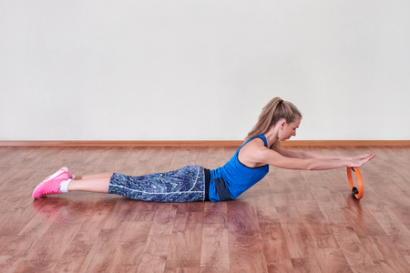 Female athlete doing sport exercise. Concept of health and body care.