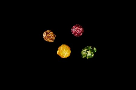 multicolored caramel popcorn on a black background.