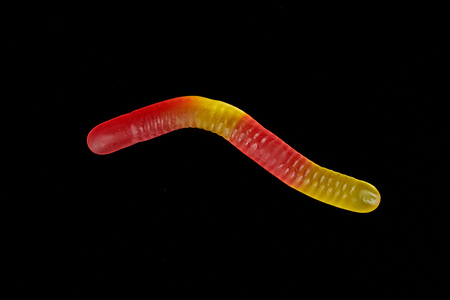 gummy jelly worm candy on a black background. Фото со стока