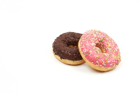 Tasty chocolate donut and Pink donut with colorful sprinkles on white background.