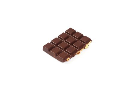 bar of dark chocolate with hazelnuts. Pieces of chocolate with nuts, isolated on white background. Reklamní fotografie