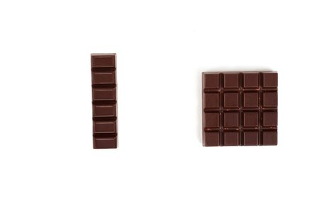 Set with different kinds of chocolate on white background.
