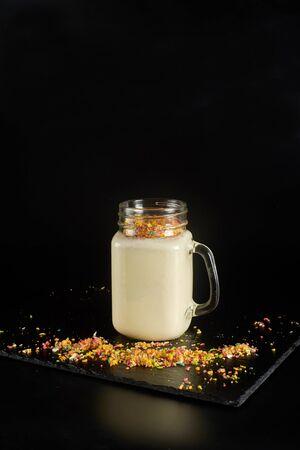 Milkshake with festive decoration on a dark background 版權商用圖片
