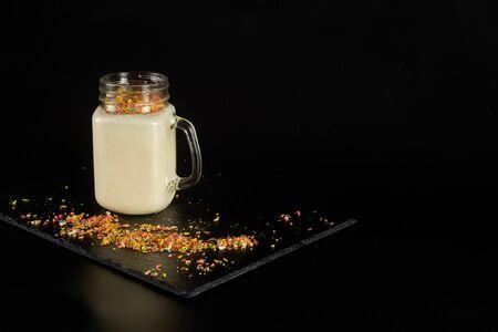 Milkshake with festive decoration on a dark background.