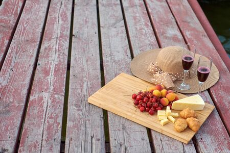 Two glasses of red wine, served outdoor with fruits Stok Fotoğraf