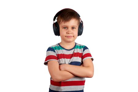 Adorable cute child enjoying favorite songs using wireless headphones. isolated on white background. Leisure, music and entertainment concept. Stok Fotoğraf