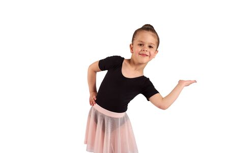 A little girl in a dance suit gracefully shows somewhere with her hand Imagens - 150115952