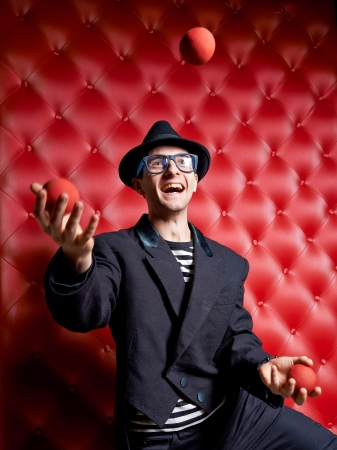 comedian: The clown the man, juggles with balls Stock Photo